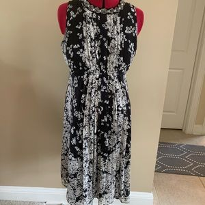 Maternity beaded and pleated floral dress